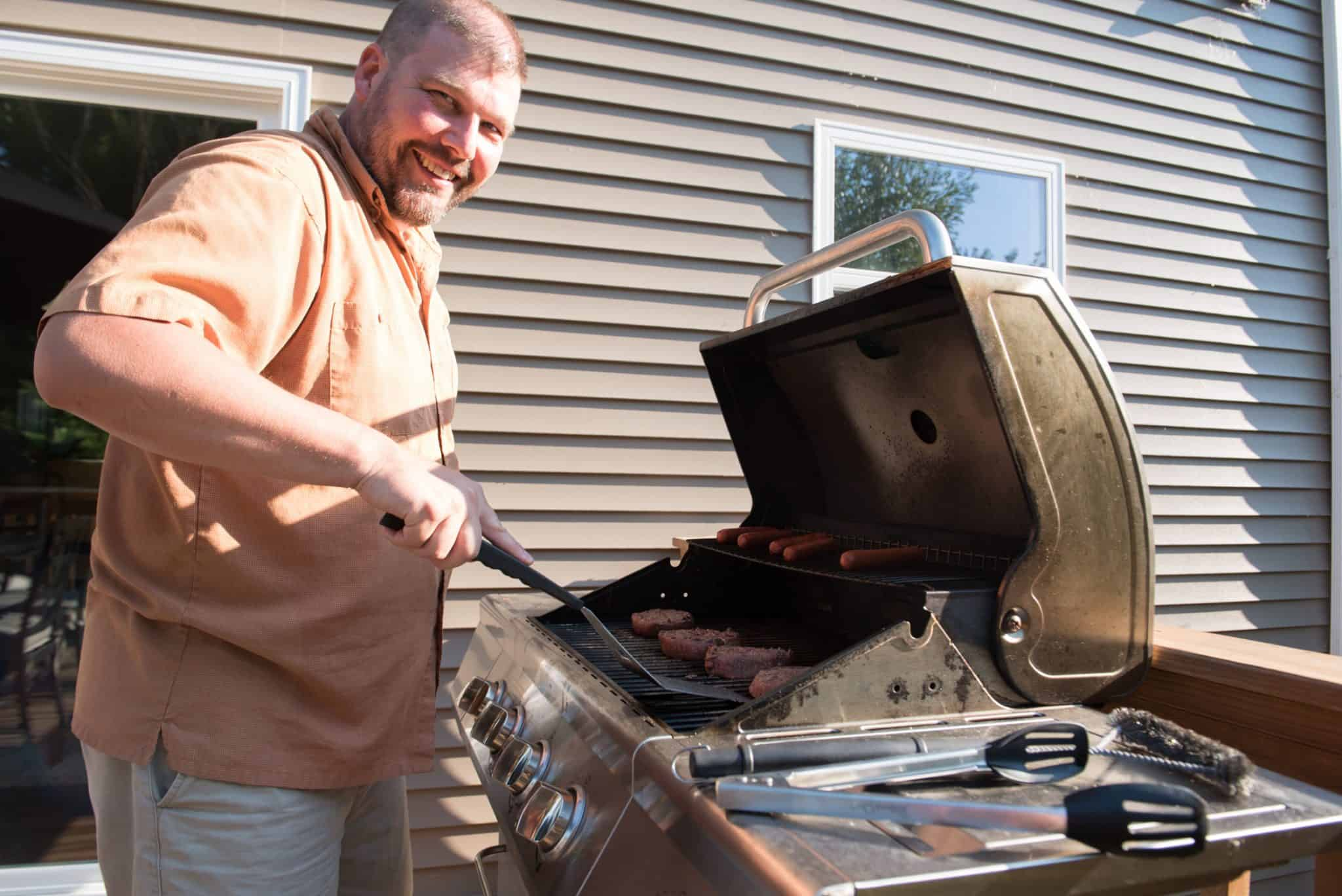 Grilling hamburgers for the Apex Filling Systems family cookout