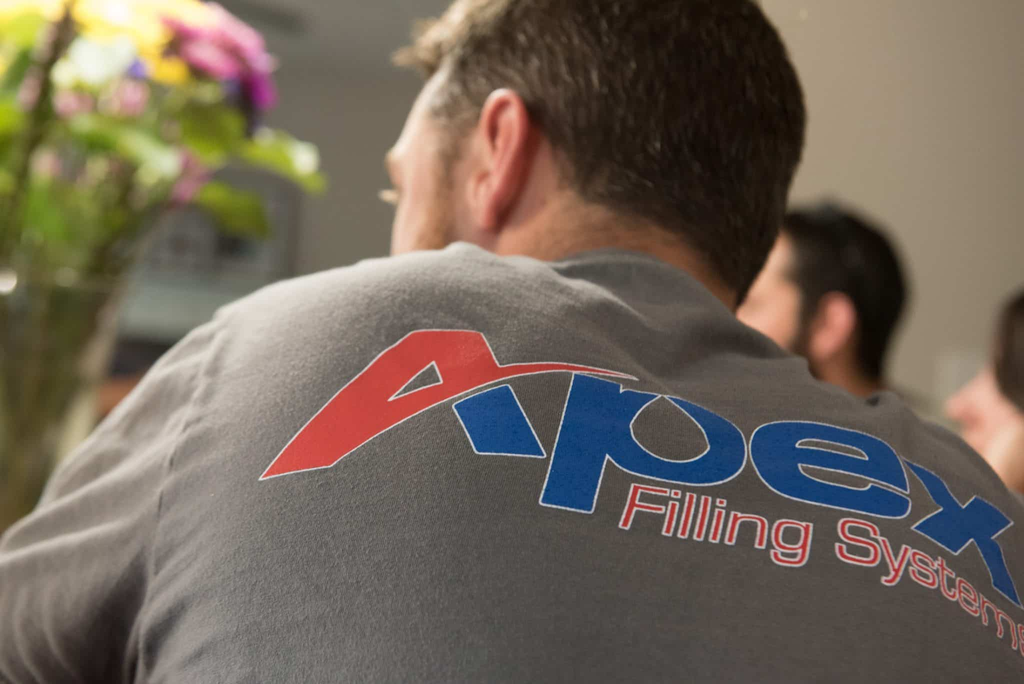 Closeup of an Apex Filling Systems t-shirt