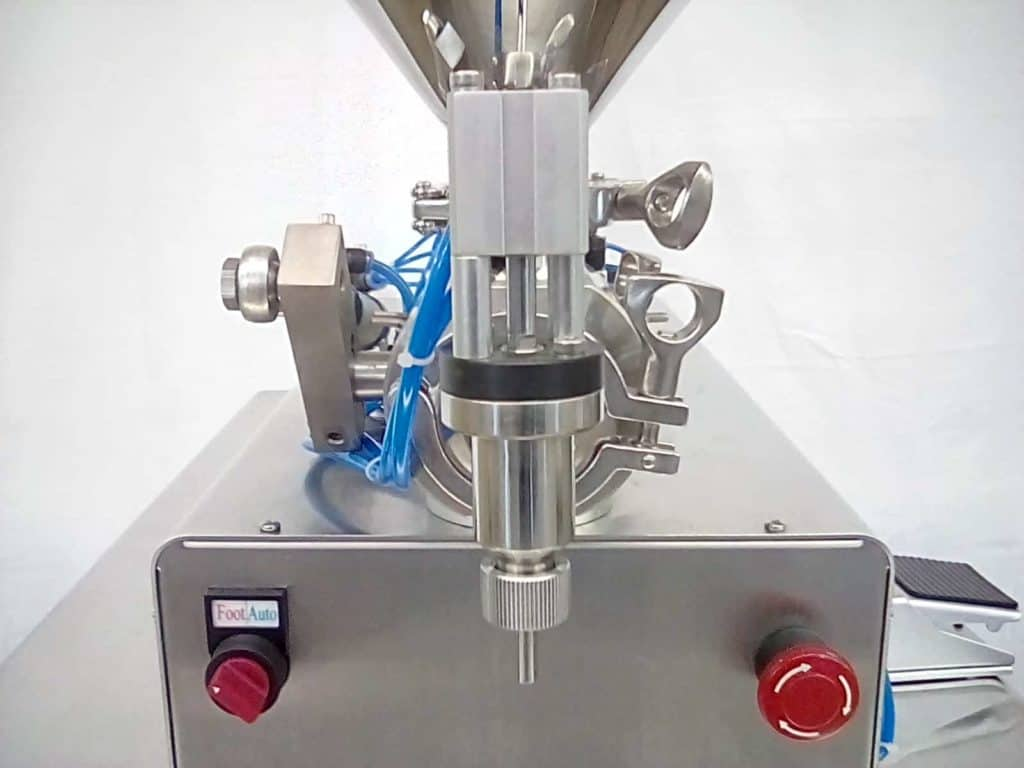 Close up of a semi-automatic tabletop piston filler