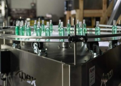 A Turntable holds bottles filled with liquid