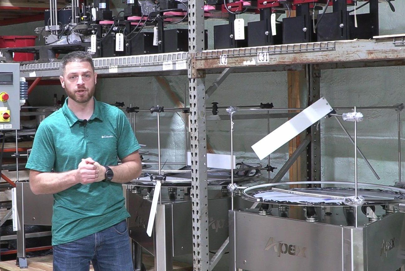 Darren Allie Stands in front of Quickship Machinery